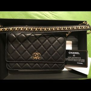 Chanel authentic black gold purse with strap